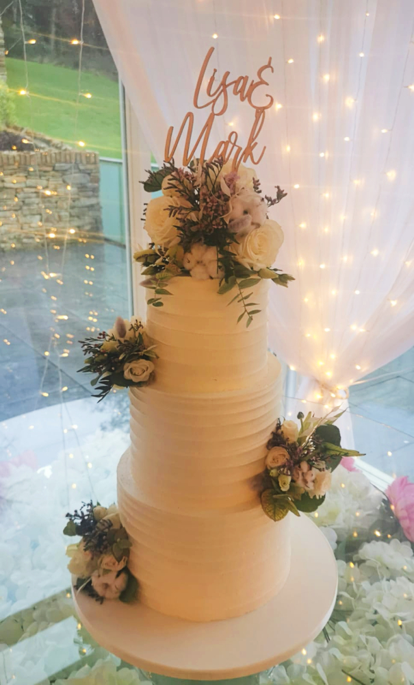 Devine Ridged Icing and Flowers Wedding Cake